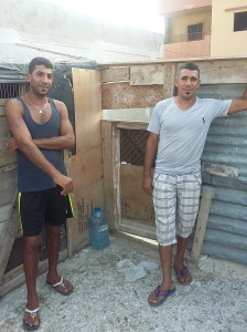Hussein and Yousaf on the rooftop with their pigeons