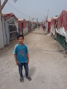 Ahmad showing me round the tent settlement